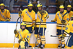 March 25,  2011             Michigan players wait for the outcome of a video review, after an iffy goal by University of Michigan defenseman Greg Pateryn (2).  The goal was ruled good by officials and the University of Michigan Wolverines defeated the University of Nebraska -Omaha Mavericks in the sudden death overtime period 3-2, after regulation time ended with a 2-2 tie.  The officials took several minutes to make a ruling on a goal, which resulted in the Michigan team's win. They will advance after the win in the first semifinal game at the NCAA Division 1 Men's West Regional Hockey Tournament, played on Friday March 25, 2011 at the Scottrade Center in downtown St. Louis.