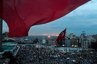Turkish flags wave over Taksim Square, Tuesday, June 4, 2013, in Istanbul, Turkey. (Seamus Travers/pressphotointl.com)