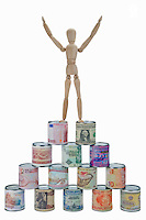 Wooden mannequin on worldwide banknotes pyramid (Licence this image exclusively with Getty: http://www.gettyimages.com/detail/102918635 )