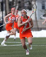 Syracuse University midfielder Brenna Rainone (7) brings the ball forward.   Syracuse University (orange) defeated Boston College (white), 17-12, on the Newton Campus Lacrosse Field at Boston College, on March 27, 2013.