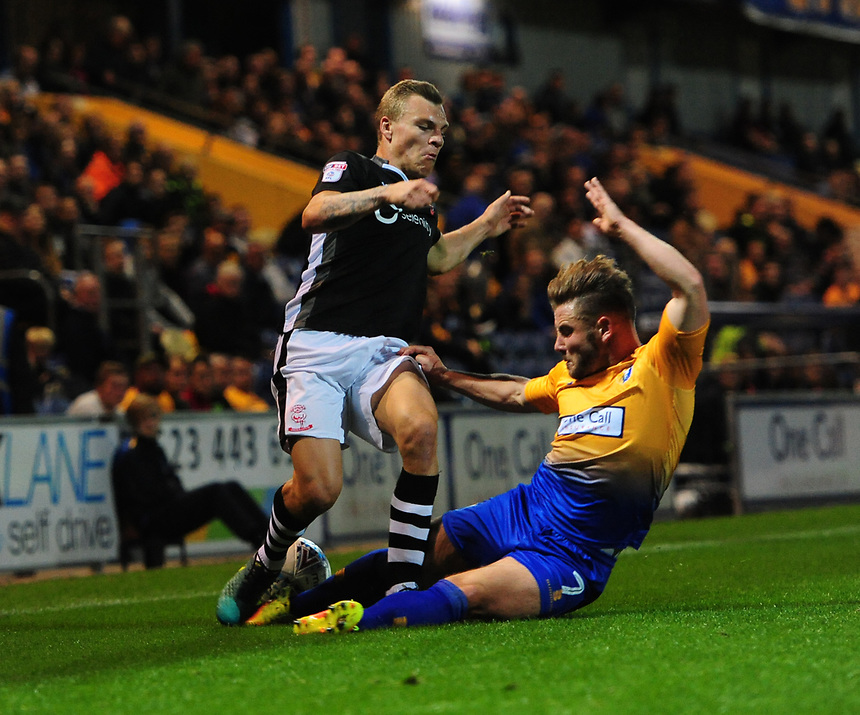 Lincoln City's Harry Anderson is fouled by Mansfield Town's Alex MacDonald<br /> <br /> Photographer Chris Vaughan/CameraSport<br /> <br /> The EFL Checkatrade Trophy - Mansfield Town v Lincoln City - Tuesday 29th August 2017 - Field Mill - Mansfield<br />  <br /> World Copyright &copy; 2018 CameraSport. All rights reserved. 43 Linden Ave. Countesthorpe. Leicester. England. LE8 5PG - Tel: +44 (0) 116 277 4147 - admin@camerasport.com - www.camerasport.com