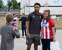 Lincoln City's Bruno Andrade poses for a photograph with fans after arriving at the ground<br /> <br /> Photographer Chris Vaughan/CameraSport<br /> <br /> The EFL Sky Bet League One - Lincoln City v Fleetwood Town - Saturday 31st August 2019 - Sincil Bank - Lincoln<br /> <br /> World Copyright © 2019 CameraSport. All rights reserved. 43 Linden Ave. Countesthorpe. Leicester. England. LE8 5PG - Tel: +44 (0) 116 277 4147 - admin@camerasport.com - www.camerasport.com