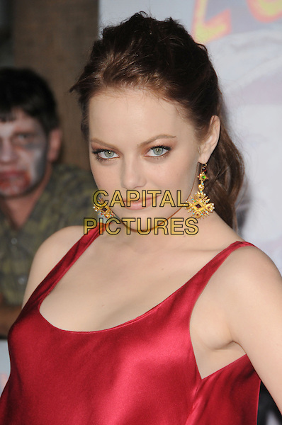 EMILY STONE .The Columbia Pictures L.A. Premiere of 'Zombieland' held at The Grauman's Chinese Theatre in Hollywood, California, USA..September 23rd, 2009                                                                   .headshot portrait dangling gold earrings red silk satin eyeshadow beauty .CAP/DVS.©Debbie VanStory/Capital Pictures.