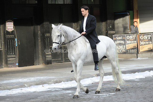 WWW.ACEPIXS.COM . . . . . .December 12, 2012...New York City....Russell Crowe and Colin Farrell ride horses on the film set ' Winter's Tale' in the Meatpacking District on December 12, 2012 in New York City ....Please byline: KRISTIN CALLAHAN - ACEPIXS.COM.. . . . . . ..Ace Pictures, Inc: ..tel: (212) 243 8787 or (646) 769 0430..e-mail: info@acepixs.com..web: http://www.acepixs.com .