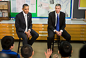 "United States President Barack Obama and U.S. Secretary of Education Arne Duncan visit with sixth grade students at the Graham Road Elementary School in Falls Church, Virginia on Tuesday, January 19, 2010. Following his meeting with students the President will deliver remarks on his ""Race To The Top"" program and his request for an additional $1.35 billion in 2011 for the program. .Credit: Kristoffer Tripplaar / Pool via CNP"