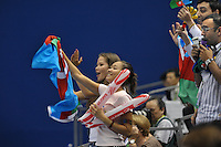 September 12, 2009; Mie, Japan;  (L-R) Dinara Gimatova and Aliya Gareyeva of Azerbaijan with other delegation members cheer for Azerbaijani rhythmic group as they begin routine in group All Around competition at the 2009 World Championships Mie, Japan. Photo by Tom Theobald.