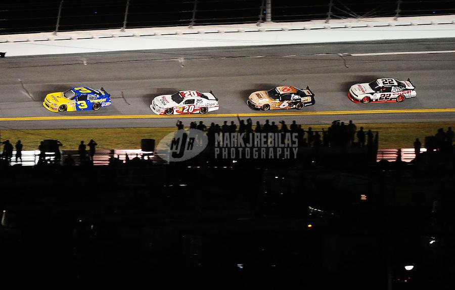 Jul. 2, 2010; Daytona Beach, FL, USA; NASCAR Nationwide Series driver Dale Earnhardt Jr. (3) leads Joey Logano (20), Ricky Stenhouse Jr (6) and Brad Keselowski (22) during the Subway Jalapeno 250 at Daytona International Speedway. Mandatory Credit: Mark J. Rebilas-
