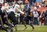 Philadelphia, PA - December 12, 2015:    Navy Midshipmen quarterback Keenan Reynolds (19) gets tackled by Army Black Knights defensive lineman John Voit (59) during the 116th game between Army vs Navy at Lincoln Financial Field in Philadelphia, PA. (Photo by Elliott Brown/Media Images International)