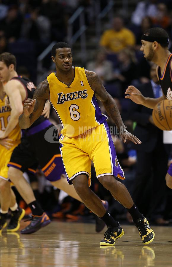 Jan. 30, 2013; Phoenix, AZ, USA: Los Angeles Lakers forward Earl Clark (6) against the Phoenix Suns at the US Airways Center. Mandatory Credit: Mark J. Rebilas-