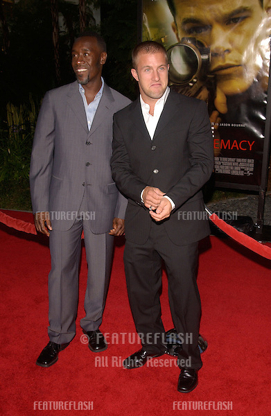 Actors SCOTT CAAN (right) & DON CHEADLE at the world premiere, in Hollywood, of The Bourne Supremacy..July 15, 2004