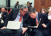 White House Counsel Charles F.C. Ruff, left, and United States President Bill Clinton's personal counsel David Kendall, right, discuss Ken Starr's presentation before the U.S. House Judiciary Committee hearing on pending Articles of Impeachment against the President on Capitol Hill in Washington, D.C. on November 19, 1998..Credit: Ron Sachs / CNP