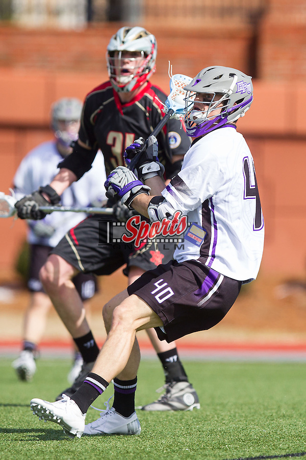 Bucky Smith (40) of the High Point Panthers on the attack against the VMI Keydets at Vert Track, Soccer & Lacrosse Stadium on March 8, 2014 in High Point, North Carolina.  The Panthers defeated the Keydets 9-8.   (Brian Westerholt/Sports On Film)