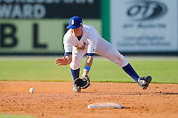 Alex McClure #2 of the Burlington Royals fields a ground ball against the Kernersville Bulldogs in an exhibition game at Burlington Athletic Stadium June20, 2010, in Burlington, North Carolina.  Photo by Brian Westerholt / Four Seam Images
