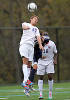 HYATTSVILLE, MD - OCTOBER 26, 2012:  Brendan Burke (25) of DeMatha Catholic High School wins a header against Nelson Reed (11) of St. Albans during a match at Heurich Field in Hyattsville, MD. on October 26. DeMatha won 2-0.