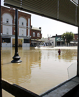 A United States Coast Guard airboat glides down Main Street as flood waters from the Blanchard River start to recede after heavy rains caused flooding Thursday, August 23, 2007, in Findlay, Ohio. The Blanchard River was close to 7 feet above flood stage at Findlay yesterday morning, the highest since a 1913 flood.