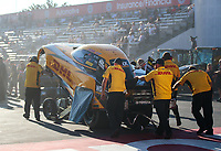 Nov 9, 2018; Pomona, CA, USA; Crew members push the car of NHRA funny car driver J.R. Todd during qualifying for the Auto Club Finals at Auto Club Raceway. Mandatory Credit: Mark J. Rebilas-USA TODAY Sports