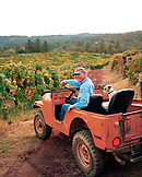 USA, California, Greg Boeger and his dog Kirby check on the vines at the Boeger Winery in Placerville, Gold Country