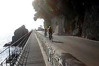 Ciclisti lungo la strada panoramica tra Portofino e Santa Margherita Ligure.<br /> Cyclists make their way along the corniche road from Portofino to Santa Margherita Ligure, Liguria, Northern Italy.<br /> UPDATE IMAGES PRESS/Riccardo De Luca