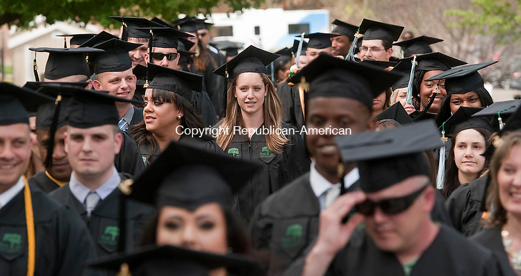 WATERBURY, CT--050915JS04-  Graduates make their way to the Great Lawn for the Post University's 2015 Commencement Saturday at Post University in Waterbury. <br /> Jim Shannon Republican-American