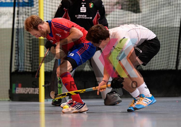 GER - Mannheim, Germany, November 28: During the 1. Bundesliga Sued Herren indoor hockey match between Mannheimer HC (red) and TG Frankenthal (white) on November 28, 2015 at Irma-Roechling-Halle in Mannheim, Germany. Final score 7-7 (HT 3-3).  Fabian Pehlke #23 of Mannheimer HC<br /> <br /> Foto &copy; PIX-Sportfotos *** Foto ist honorarpflichtig! *** Auf Anfrage in hoeherer Qualitaet/Aufloesung. Belegexemplar erbeten. Veroeffentlichung ausschliesslich fuer journalistisch-publizistische Zwecke. For editorial use only.