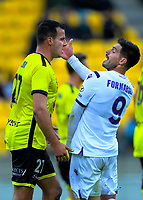 Perth's Bruno Fornaroli (right) expresses his feelings to Phoenix captain Steven Taylor during the A-League football match between Wellington Phoenix and Perth Glory at Westpac Stadium in Wellington, New Zealand on Sunday, 27 October 2019. Photo: Dave Lintott / lintottphoto.co.nz