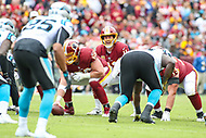 Landover, MD - October 14, 2018: Washington Redskins quarterback Alex Smith (11) calls a play during the  game between Carolina Panthers and Washington Redskins at FedEx Field in Landover, MD.   (Photo by Elliott Brown/Media Images International)