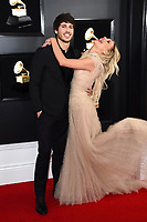 Morgan Evans, left, and Kelsea Ballerini arrive at the 61st annual Grammy Awards at the Staples Center on Sunday, Feb. 10, 2019, in Los Angeles. (Photo by Jordan Strauss/Invision/AP)