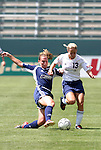 27 June 2004: Christie Rampone (left) and Kristine Lilly (13). The Philadelphia Charge defeated the San Jose CyberRays 2-0 at the Home Depot Center in Carson, CA in Womens United Soccer Association soccer game featuring guest players from other teams.