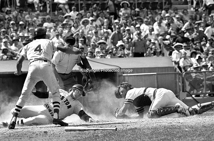 Oakland A's catcher Dave Duncan fields throw to the plate in time to tag out Boston Red Sox runner...<br />