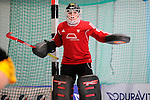 Mannheim, Germany, January 24: During the 1. Bundesliga Damen Hallensaison 2014/15 quarter-final hockey match between Mannheimer HC (white) and Harvestehuder THC (black) on January 24, 2015 at Irma-Roechling-Halle in Mannheim, Germany. Final score 2-3 (2-2). (Photo by Dirk Markgraf / www.265-images.com) *** Local caption *** Rosa Krueger #32 of Harvestehuder THC