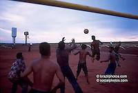 Sports. Indigenous people playing soccer. Sugarcane mill. Sugarcane cutters during leisure time. State: Mato Grosso do Sul, Brazil.