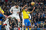 Garet Bale of Real Madrid competes for the ball with Mauricio Lemos of UD Las Palmas during the match of Spanish La Liga between Real Madrid and UD Las Palmas at  Santiago Bernabeu Stadium in Madrid, Spain. March 01, 2017. (ALTERPHOTOS / Rodrigo Jimenez)