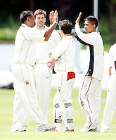 Hornsey players celebrate dismissing Adam Holmes during the Middlesex County League Division two game between North Middlesex and Hornsey at Park Road, Crouch End on Sat July 9, 2011
