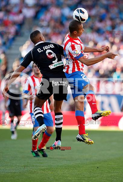 Atletico's Miranda and Granada's El Arabi during La Liga BBVA match. April 14, 2013.(ALTERPHOTOS/Alconada)