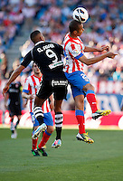 Atletico's Miranda and Granada's El Arabi during La Liga BBVA match. April 14, 2013.(ALTERPHOTOS/Alconada)