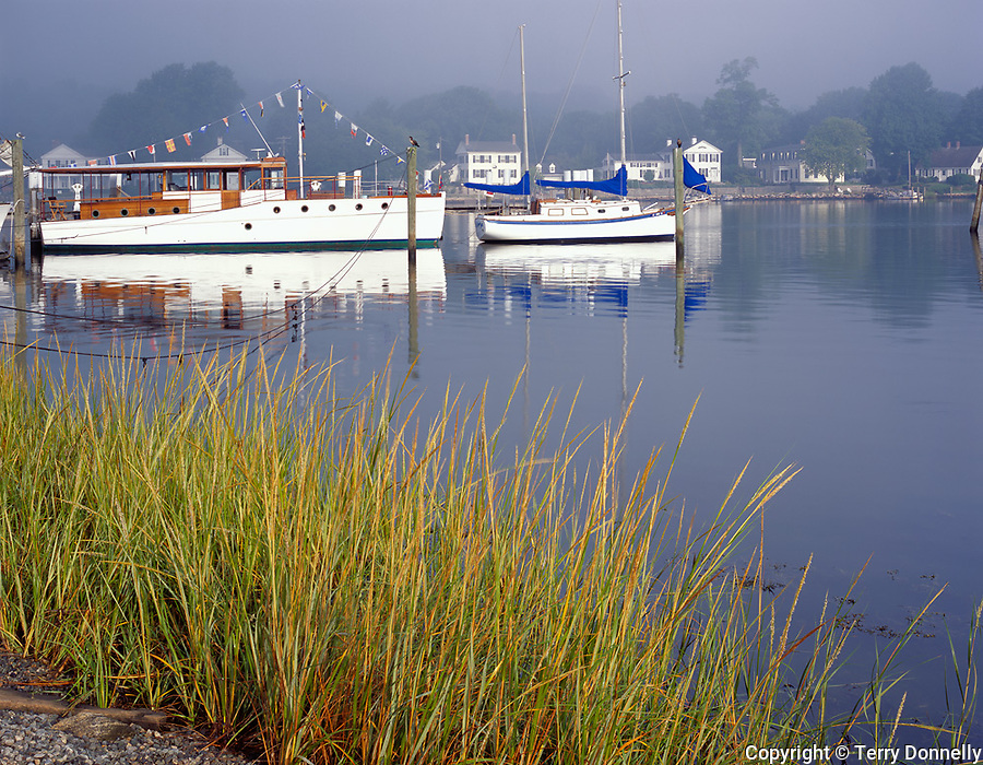 Mystic, CT<br /> Boats anchored at the Mystic River harbor in clearing fog