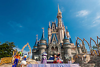 Disney characters perform in front of the Cinderella Castle, Magic Kingdom, Walt Disney World, Orlando, Florida USA