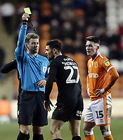 Blackpool's Jordan Thompson looks on as Barnsley's Alex Mowatt is shown a yellow card by referee Anthony Backhouse<br /> <br /> Photographer Rich Linley/CameraSport<br /> <br /> The EFL Sky Bet League One - Blackpool v Barnsley - Saturday 22nd December 2018 - Bloomfield Road - Blackpool<br /> <br /> World Copyright &copy; 2018 CameraSport. All rights reserved. 43 Linden Ave. Countesthorpe. Leicester. England. LE8 5PG - Tel: +44 (0) 116 277 4147 - admin@camerasport.com - www.camerasport.com