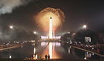 The Washington Monument lights up and is reflected in the reflecting pool during the millennium celebration in Washington January 1. Washington ushered in 2000 with rap, rock, a Steven Spielberg film and fireworks by the Washington Monument.   (photo by Michael Smith)