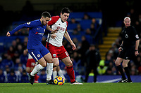 Eden Hazard of Chelsea tries to shake off a challenge from West Brom's Gareth Barry during Chelsea vs West Bromwich Albion, Premier League Football at Stamford Bridge on 12th February 2018