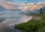 Bridger-Teton National Forest, Wyoming:<br /> Dawn light and fog with reflections of the Wind River Range on the Green River