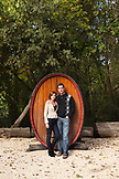 USA, California, Sonoma, travelers on a wine tour stand in front of a large wine barrel at the Buena Vista Carneros winery