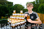 Young Entrepreneur Cian Wall from Derrymore, harvest, his latest crop of locally made honey