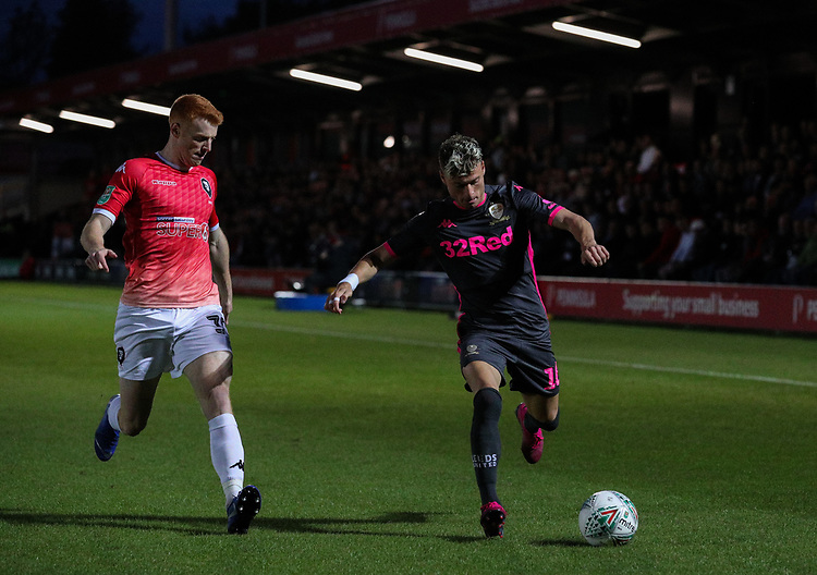 Leeds United's Ezgjan Alioski gets away from Salford City's Rory Gaffney<br /> <br /> Photographer Alex Dodd/CameraSport<br /> <br /> The Carabao Cup First Round - Salford City v Leeds United - Tuesday 13th August 2019 - Moor Lane - Salford<br />  <br /> World Copyright © 2019 CameraSport. All rights reserved. 43 Linden Ave. Countesthorpe. Leicester. England. LE8 5PG - Tel: +44 (0) 116 277 4147 - admin@camerasport.com - www.camerasport.com
