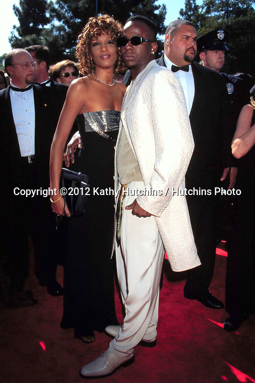 LOS ANGELES - SEP 13:  Bobby Brown, Whitney Houston arriving at the 50TH ANNUAL PRIMETIME EMMY'S at Shrine Auditorium on September 13, 1998 in Los Angeles, CA