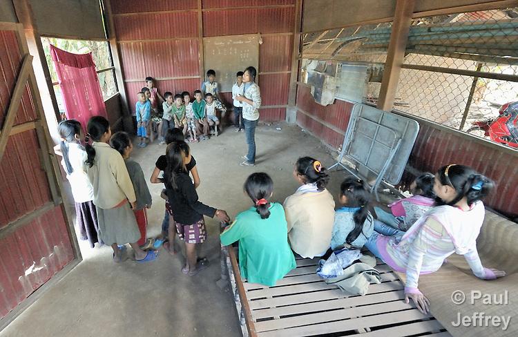 Children participate in a church school class in the Methodist Church in the Cambodian village of Talom.