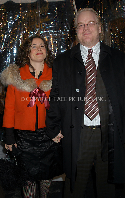 Philip Seymour Hoffman and wife arrive at the New York film premiere of 'Cold Mountain' at the Ziegfeld Theatre. December 09 2003. Please byline: AJ SOKALNER/NY Photo Press.   ..*PAY-PER-USE*      ....NY Photo Press:  ..phone (646) 267-6913;   ..e-mail: info@nyphotopress.com