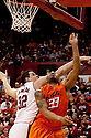 12 February 2011: Oklahoma State Cowboys forward Marshall Moses #33 gets hit in the head by Nebraska Cornhuskers center Andre Almeida #32 as he makes the shot from underneath during the second half at the Devaney Sports Center in Lincoln, Nebraska. Nebraska defeated Oklahoma State 65 to 54.
