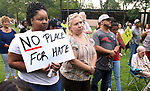 WATERBURY CT. 14 August 2017-081417SV09-Lovely Ingram of Waterbury holds a No Place For Hate sign while listening to speakers at a &quot;solidarity&quot; gathering in Library Park in Waterbury Monday. The gathering was in response to Saturday's protests in Charlottesville, VA. <br /> Steven Valenti Republican-American