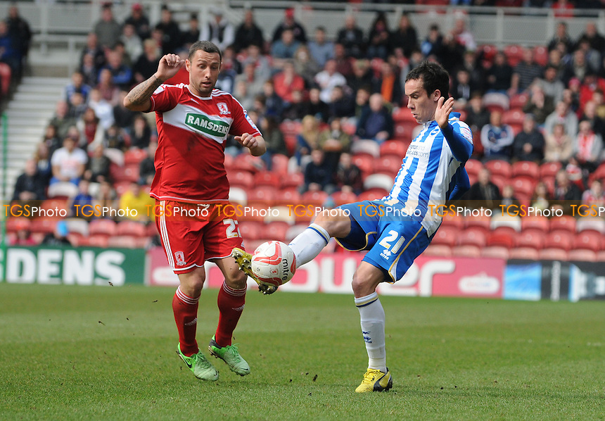 David López of Brighton & Hove Albion battles with Scott McDonald of Middlesbrough - Middlesbrough vs Brighton & Hove Albion - NPower Championship Football at the Riverside Stadium, Middlesbrough - 13/04/13 - MANDATORY CREDIT: Steven White/TGSPHOTO - Self billing applies where appropriate - 0845 094 6026 - contact@tgsphoto.co.uk - NO UNPAID USE.